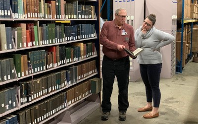 Librarian Bruce Kreuger helping a patron find information in the State Historical Archives.