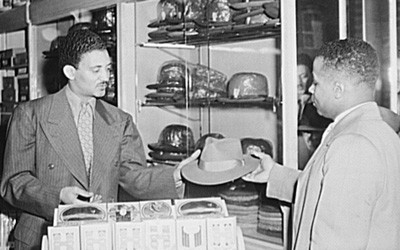 Salesman Selling a Hat to a Customer in Chicago, Illinois, April 1952