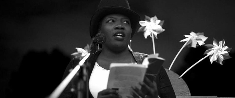 African American woman reading from book