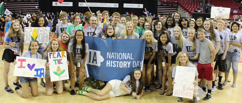 Large group of National History Day student participants with banners