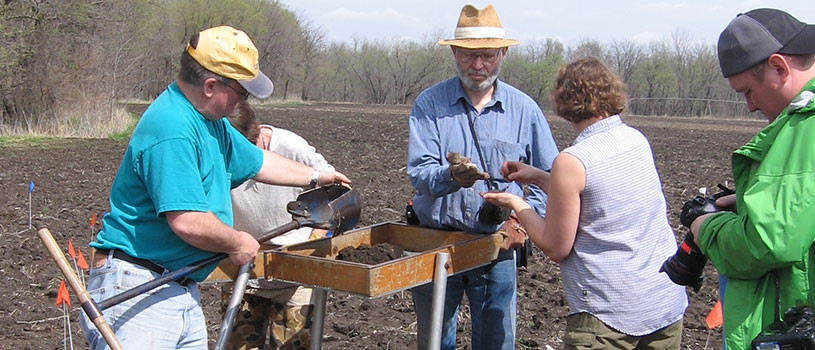Archaeologists working in the field