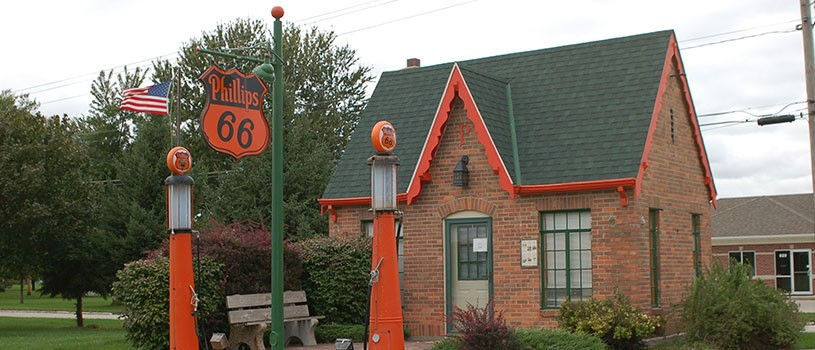 Old brick house that's a Phillip 66 gas station