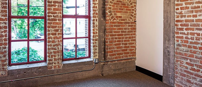 Interior red brick and beams of historic preservation of project