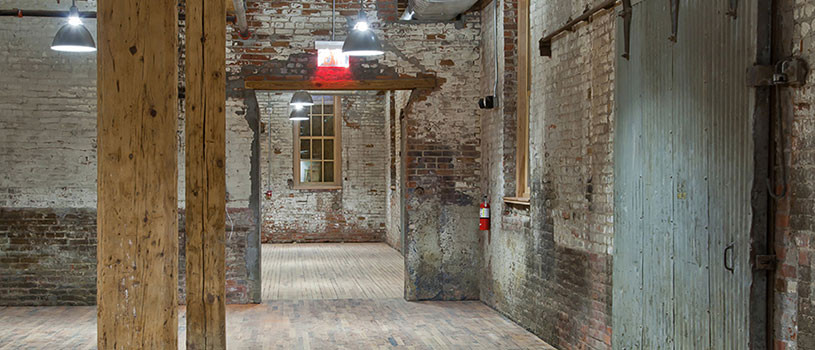 Preservation sites exposed brick interior with wood posts