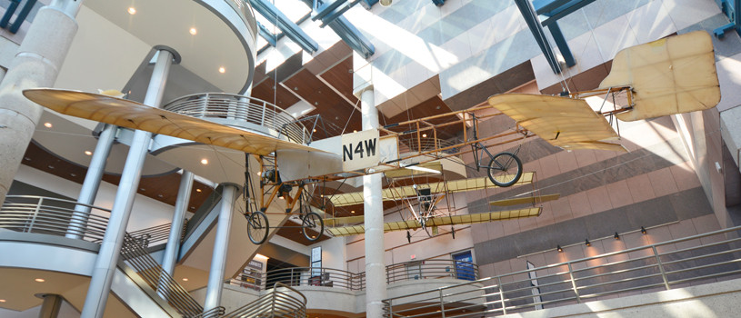 Historic Bleriot and Curtiss Pusher airplanes.